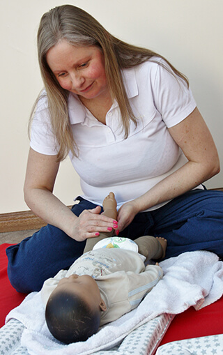 Karen carrying out baby massage
