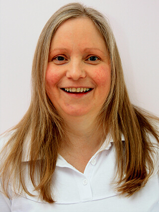 About Karen Hooton your therapist in a white top providing complementary therapies in Edinburgh, Midlothian and surrounding areas