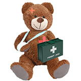 Teddy Bear with a green with a white cross first aid box, a sling on its right arm and plasters on head and heart for baby and child frist aid