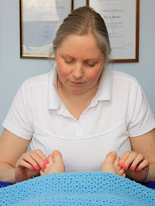 Karen Hooton, your therapist, carrying out reflexology on the feet