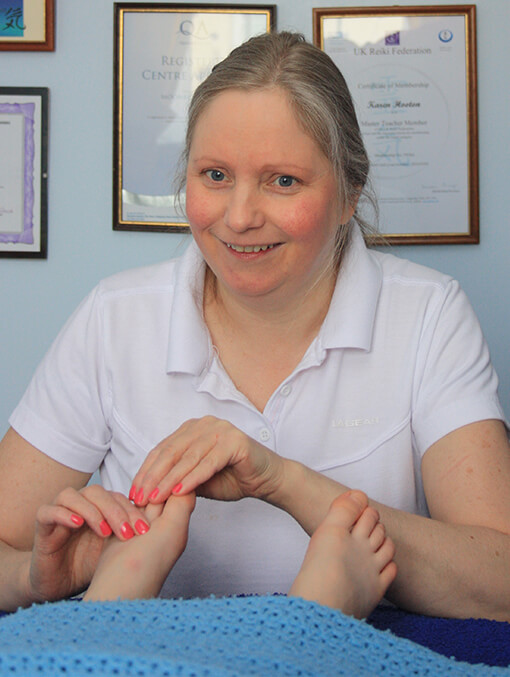 Karen carrying out reproflexology/fertility reflexology
